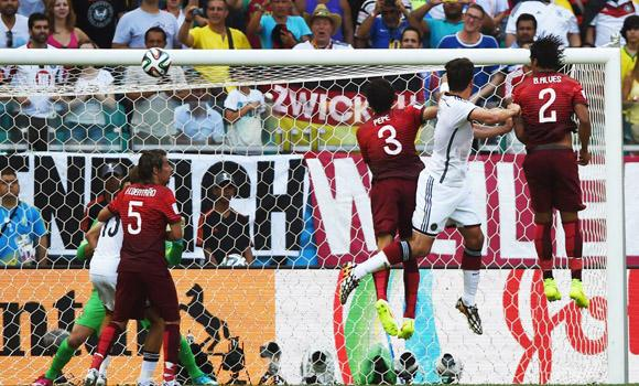 Germany's defender Mats Hummels (2R) leaps to score during the Group G football match between Germany and Portugal at the Fonte Nova Arena in Salvador on Monday during the 2014 FIFA World Cup.