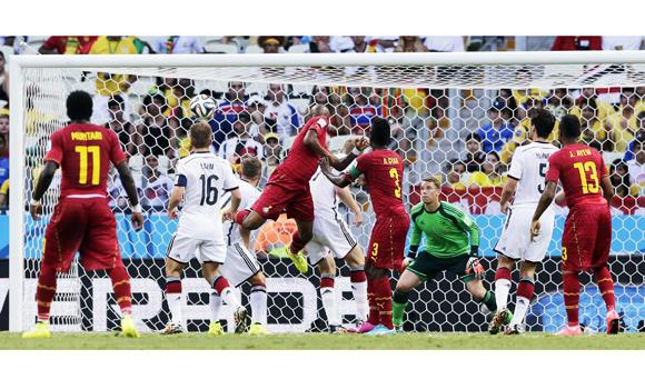 Ghana's Andre Ayew, center, scores his side's first goal during the group G World Cup soccer match between Germany and Ghana at the Arena Castelao in Fortaleza, Brazil, on Saturday.