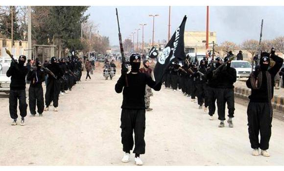 Fighters from the al-Qaeda breakaway group Islamic State of Iraq and the Levant (ISIL) march in Raqqa, Syria, in this file photo. An activist group said Tuesday that more than 630 people had been killed as of the end April in infighting between the ISIL and other anti-Assad groups.