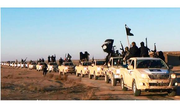 This file image posted on a militant website on Jan. 7, 2014, which is consistent with AP reporting, shows a convoy of vehicles and fighters from the Al-Qaeda splinter group Islamic State of Iraq and the Levant (ISIL) fighters in Iraq's Anbar Province.