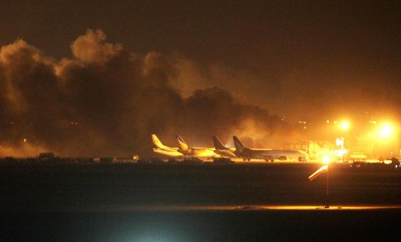 Fire illuminates the sky above the Jinnah International Airport in Karachi during an attack by Pakistani Taleban miltants on Sunday night.