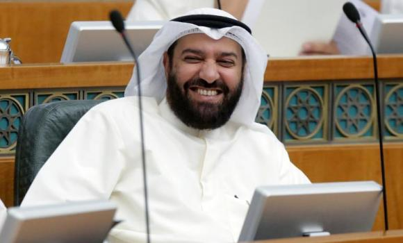 Kuwaiti Oil Minister Ali Al-Omair smiles during a parliamentary session at the national assembly in Kuwiat City. (AFP)