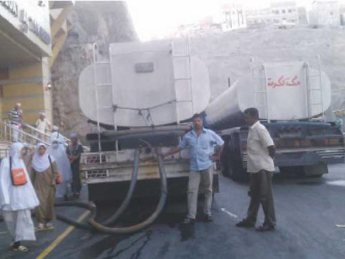 Tanker drivers deliver water to a pilgrim accommodation in Makkah.