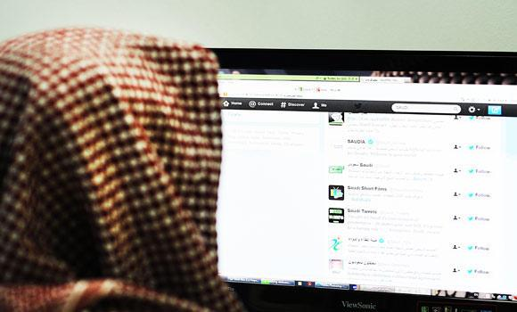 A Saudi man browses through twitter on his desktop in Riyadh.