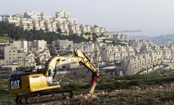 In a file picture taken on March 19, 2014, a bulldozer is seen next to a new housing construction site in the Israeli settlement of Har Homa (background), known to Palestinians as Jabal Abu Ghneim, in Israeli annexed east Jerusalem. Israel on May 26, 2014 approved plans for 50 new settler homes in Har Homa in annexed east Jerusalem as Pope Francis wrapped up a visit to the region. It has now announced plans to construct 1,500 more settler homes in reaction to the formation of a Palestinian unity government. (AFP)