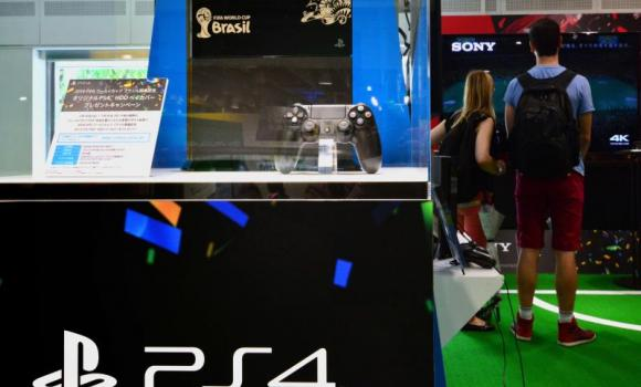A special designed console by Sony Computer Entertainment's video game console PlayStation 4 is displayed at a Sony showroom in Tokyo.