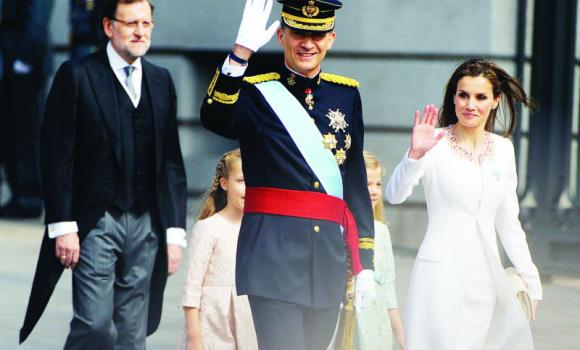 King Felipe VI gestures as he arrives for a swearing in ceremony of Spain's new King in Madrid on Thursday.
