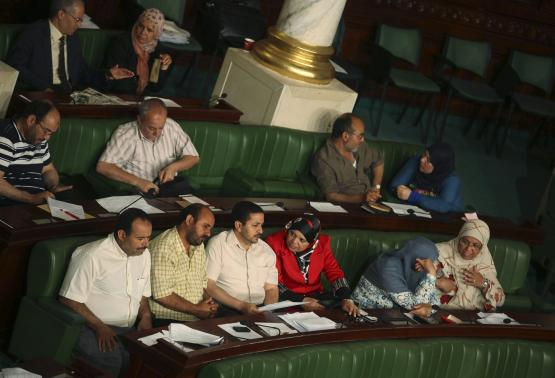 Members of the Tunisian parliament attend a meeting at the Constituent Assembly in Tunis June 25, 2014. Tunisia's parliament on Wednesday agreed to hold parliamentary elections on October 26 and a presidential poll a month later, another step towards full democracy in the country that toppled its autocrat ruler in 2011.