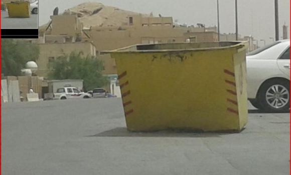 A waste container stands in the middle of a road in Riyadh, posing a danger to motorists.