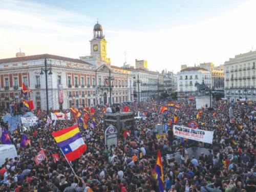 Pro-republic supporters wave republican flags and carry placards demonstrate in Madrid on Sunday.