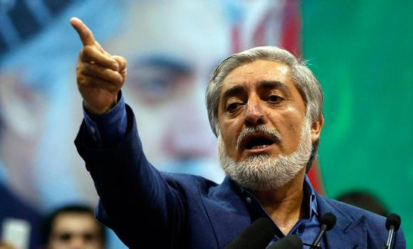 Afghan presidential candidate Abdullah Abdullah gestures during a gathering of his supporters in Kabul, July 8, 2014. Abdullah told thousands of supporters on Tuesday he was the winner of last month's run-off election, putting himself on a collision course with his arch-rival, Ashraf Ghani.
