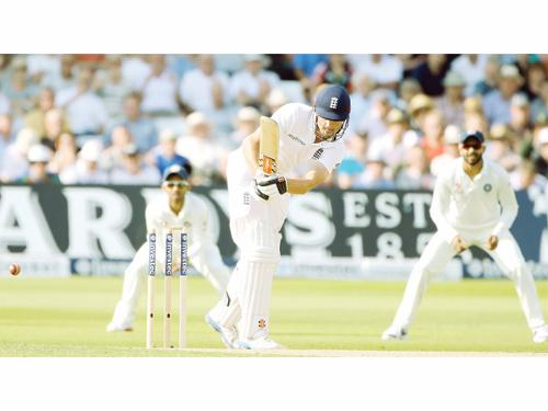England's Alastair Cook (C) is bowled by Mohammed Shami (not seen) during the second day's play in the first cricket Test match against India at Trent Bridge in Nottingham Thursday.