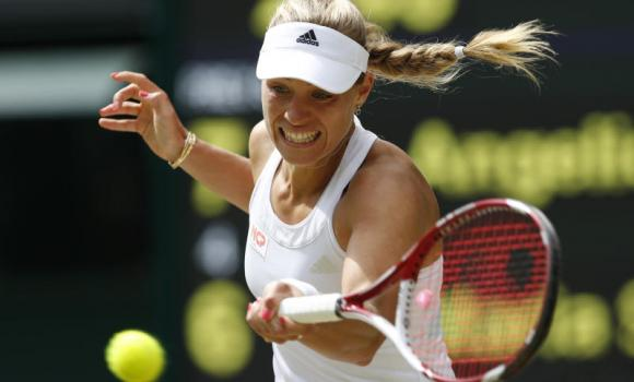 Angelique Kerber of Germany plays a return to Maria Sharapova of Russia during their women's singles match at the All England Lawn Tennis Championships in Wimbledon, London, Tuesday. Kerber won in three sets 7-6 (4), 4-6, 6-4.