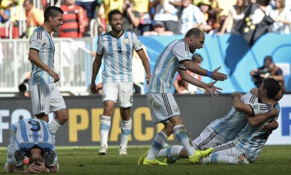 Argentina's players celebrate after winning the quarter-final football match between Argentina and Belgium at the Mane Garrincha National Stadium in Brasilia during the 2014 FIFA World Cup on July 5, 2014.