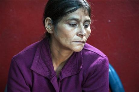 Cipriana Juarez Diaz, mother of Gilberto Francisco Ramos Juarez, a Guatemalan boy whose decomposed body was found in the Rio Grande Valley of South Texas, listens to her husband talk, during an interview at their home in San Jose Las Flores, in the northern Cuchumatanes mountains of Guatemala, Tuesday, July 1, 2014. Juarez Diaz said that she begged her son not set out on the dangerous journey from their modest cinder block- and sheet-metal home high in the northern Guatemalan mountains.