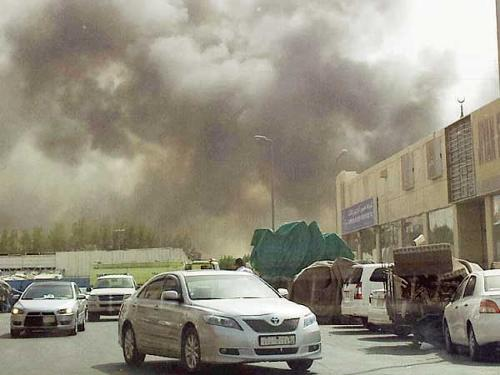 Huge smoke billows from the Harraj Market in Dammam as a huge fire in some shops destroyed goods worth millions of riyals Tuesday.