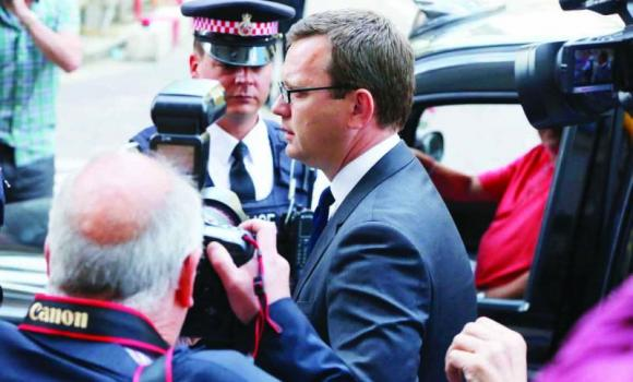Former Editor of the News of the World Andy Coulson arrives for the sentencing at the Old Bailey court house in London on Friday.