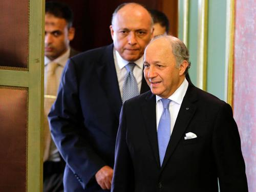 French Foreign Minister Laurent Fabius, right, is accompanied by his Egyptian counterpart Sameh Shoukry before a news conference at the Egyptian foreign ministry in Cairo, Friday.