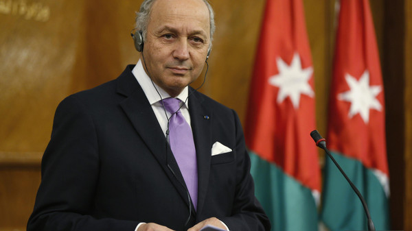 French Foreign Minister Laurent Fabius listens to his Jordanian counterpart Nasser Judeh (not pictured) during their joint news conference at the Ministry of Foreign Affairs in Amman.