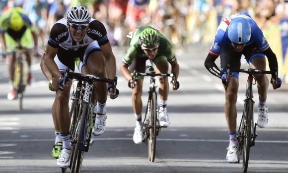 Germany's Marcel Kittel, left, sprints to win ahead of Slovakia's Peter Sagan (hidden), Lithuania's Ramunas Navardauskas,right, and France's Bryan Coquard, cener, at the end of the 190.5 km first stage of the 101st edition of the Tour de France cycling race on Saturday between Leeds and Harrogate, northern England.