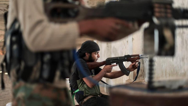 Rebel fighters during clashes with ISIS militants on the outskirts of Aleppo on July 13, 2014.