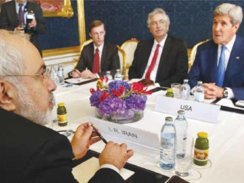 "Iran's Foreign Minister Javad Zarif (left) holds a bilateral meeting with US Secretary of State John Kerry on the second straight day of talks over Tehran's nuclear program in Vienna. Kerry pressed his Iranian counterpart to make ""critical choices"", six days before a deadline to cut a historic deal that would finally dispel fears about Tehran's nuclear drive."
