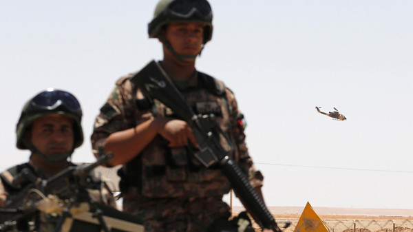 Jordanian soldiers stand guard near the Jordanian Karameh border crossing.