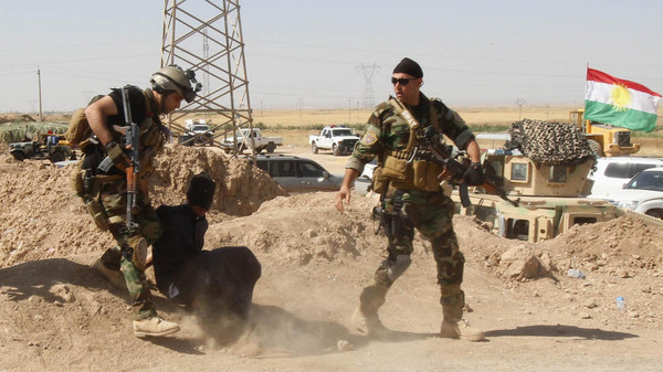 Personnel from the Kurdish security forces detain a man suspected of being a militant belonging to the al Qaeda-linked Islamic State in Iraq and the Levant (ISIL) in the outskirts of Kirkuk June 16, 2014.