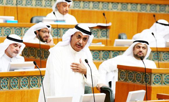 Kuwaiti Minister of Commerce and Industry Abdulmohsen al-Mudej (C) attends a parliament session at the national assembly, in this July 2, 2014 photo, in Kuwait City.