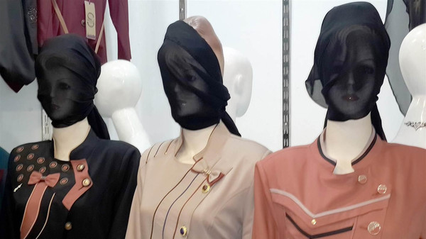 Mosul shop owners said they had been told to cover the faces of both male and female mannequins.