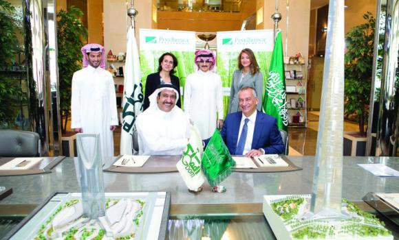 Prince Alwaleed attends the signing ceremony.