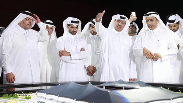 Secretary-General Hassan Al-Thawadi (3rd L) of Qatar's Supreme Committee for Delivery and Legacy, the nation's 2022 World Cup organising committee, speaks during a news conference to announce the start of work on the Al-Khor Stadium in Al-Khor June 21, 2014.