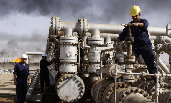Laborers work at the Rumaila oil refinery in Zubair near the city of Basra, Iraq.