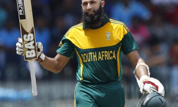 South Africa's Hashim Amla raises his bat as he celebrates his century during their first One Day International cricket match against Sri Lanka in Colombo on Sunday.