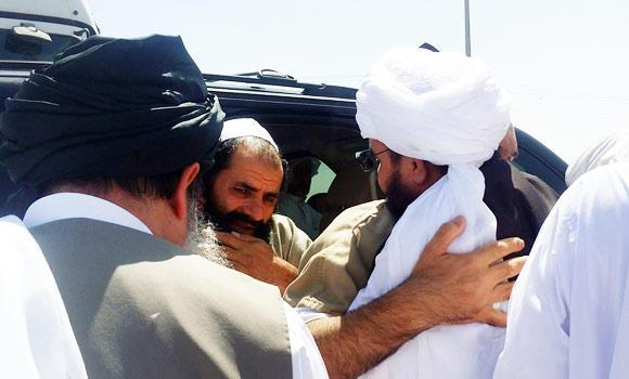 In this June 1, 2014 photo shows senior Taliban figure Mohammad Fazl (centre L-facing) being welcomed at an undisclosed location in Qatar following his release from Guantanamo Bay in exchange for a US soldier.