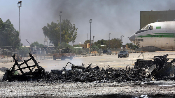 A picture taken on July 16, 2014, shows the remains of a burnt airplane at the Tripoli international airport in the Libyan capital.
