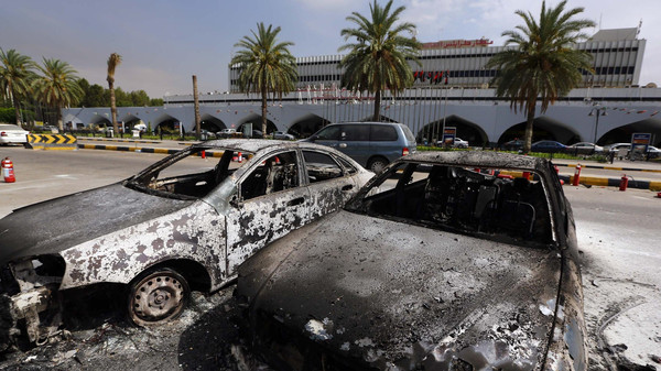 Burnt vehicles are seen in the compound of Tripoli international airport in the Libyan capital on July 14, 2014.