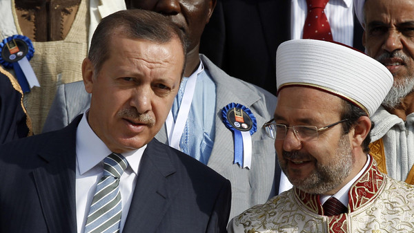 Turkey's Prime Minister Tayyip Erdogan chats with Head of Turkey's Religious Affairs Directorate Mehmet Gormez.