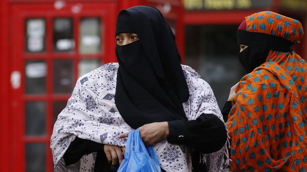 Women wearing full-face veils as they shop in London.