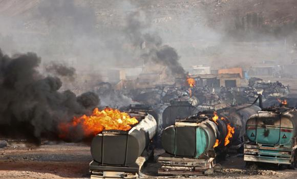 Flames rise from oil tankers after an attack claimed by Taleban militants on the outskirts of Kabul, Afghanistan, on Saturday. An Afghan security official says at least 400 fuel tankers caught fire late Friday night in a parking lot in the outskirts of Kabul.