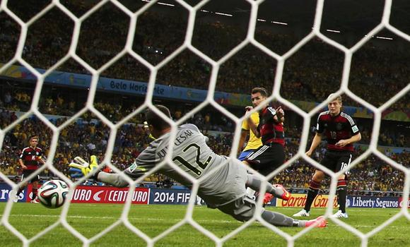 Germany's Toni Kroos (18) scores a goal during their 2014 World Cup semifinals against Brazil at the Mineirao stadium in Belo Horizonte on Tuesday.