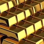 Gold hits one-month low as strong data lift stocks, dollar