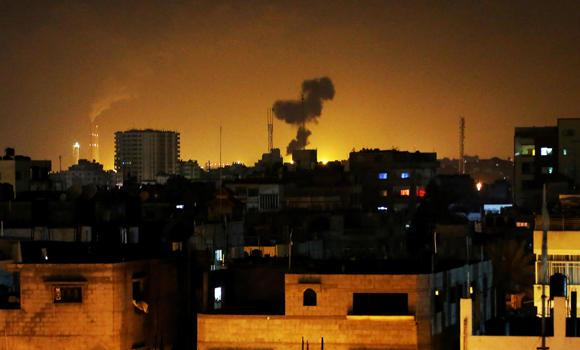 Smoke rises after an Israeli missile strike in Beit Lahia, northern Gaza Strip, early Monday. Later in the day, Gaza militants unleashed dozens of rockets on southern Israel in a retaliatory strike.