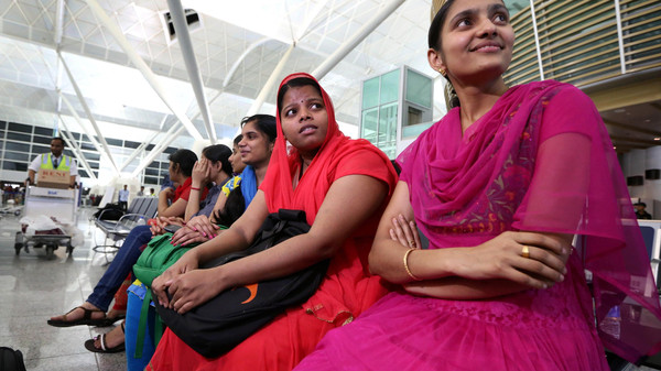 Some of the 46 Indian Nurses, held hostage by Islamic militants in Iraq, wait at the airport before flying home, on July 4, 2014, in the city of Arbil in the autonomous Kurdistan region of northern Iraq.