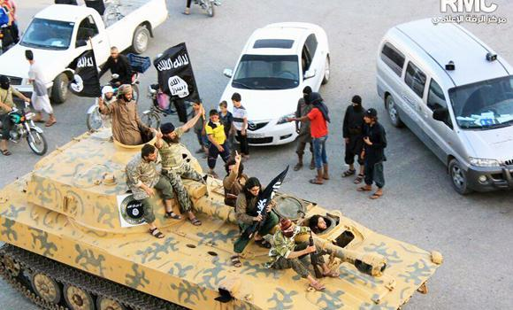 Fighters from the Islamic State of Iraq and the Levant (ISIL), part of a convoy of tanks and armored vehicles, are seen during a parade in Raqqa, Syria, in this undated image posted by the Raqqa Media Center, a Syrian opposition group.