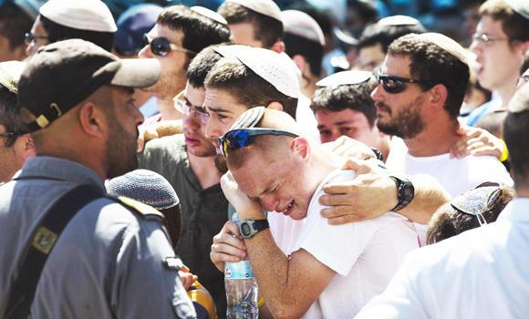 Friends and relatives mourn during a memorial service for Gil-Ad Shaer, 16, one of three Israeli teens who were abducted and killed in the occupied West Bank, before his funeral in the West Bank Jewish settlement of Talmon on Tuesday.