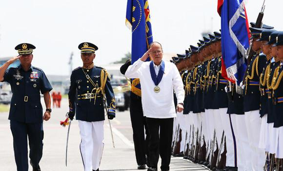 Philippine President Benigno Aquino III, third left, attends ceremonies on the 67th Philippine Air Force Anniversary at Clark Air Base in Pampanga province, northern Philippines, in this July 1, 2014, file photo. Aquino's popularity rating has plummeted in surveys amid a controversy over the use of development fund.