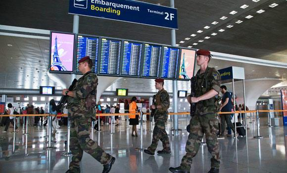 Soldiers patrol through a terminal at Paris Charles de Gaulle airport in Roissy, France, on Friday.