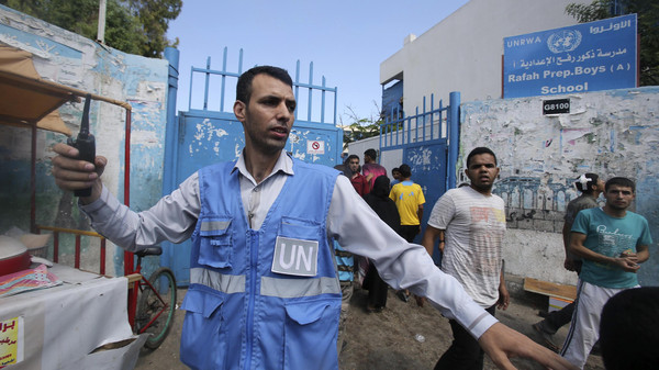 A United Nations worker gestures after what witnesses said was an Israeli air strike outside a U.N.-run school, where displaced Palestinians take refuge.