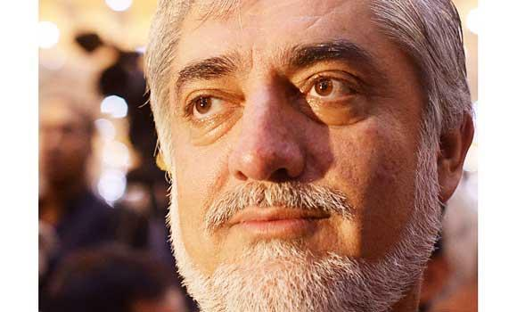Afghan presidential candidate Abdullah Abdullah looks on during a gathering in Kabul, in this August 21, 2014 photo.